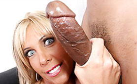 Tanned Blonde MILF Gives Intense Handjob for a Big Black Dong
