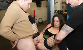 Tattooed Whore Gives Complete Service for Two Horny Stiff Dicks in a Car Service Garage